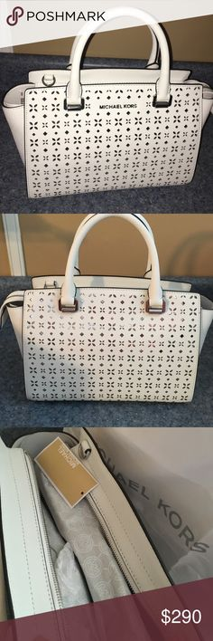 """🤑PRICE DROP: Authentic Michael Kors Beautiful Bag Gorgeous Michael Kors """"Selma"""" satchel. White with silver perforations. Silver tone hardware.  Saffiano leather. Adjustable strap. Handles. Inside pockets. 13"""" x 8"""" x 24"""" Dustbag is included! Michael Kors Bags Satchels"""