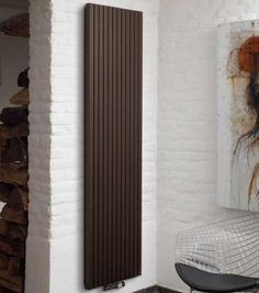 Wall radiator- can be outfitted with towel or robe rack.  Love the functionality and style!
