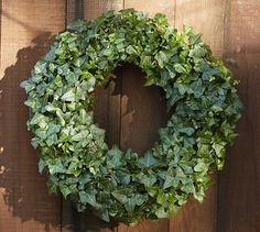 """Live Ivy Wreath #potterybarn $70-100 With layers of rich green leaves overlapping to create a lush look, this ivy wreath has a traditional, timeless quality that makes the holidays feel warm and welcoming.    Small: 13"""" diameter, 4.5"""" deep   Large: 17"""" diameter, 4.5"""" deep   Live ivy is wrapped over a moss-covered galvanized wire frame.   Burlap ribbon for hanging."""