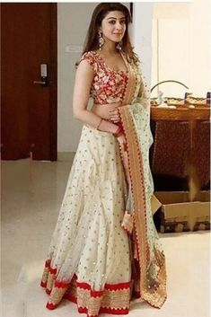 All brides dream of finding the most suitable wedding ceremony, but for this they need the ideal bridal dress, with the bridesmaid's dresses actually complimenting the brides dress. Here are a few ideas on wedding dresses. Lehenga Saree Design, Half Saree Lehenga, Lehnga Dress, Net Lehenga, Lehenga White, Banarasi Lehenga, Saree Blouse, Lehenga Designs, Half Saree Designs