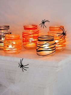 Easy DIY candleholder: Dip 48 inches of yarn into a one-part Elmer's glue, two-part water solution. Squeeze out excess; wrap strand around clean baby-food jar from top down. When dry, add an LED tealight. #halloween