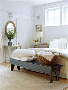 Simple, lovely bedroom that is very functional in its simplicity.  Bench at the end of the bed helps while putting on shoes ... or slippers.  Small oval mirror can help you check your appearance quickly before you leave the room.  Room on the bench for a laundry basket highly functional.  #organizing_for_tranquility