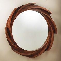 Global Views Paddle Mirror : Reminiscent of boating paddles, this expertly handcrafted walnut mirror measures 40