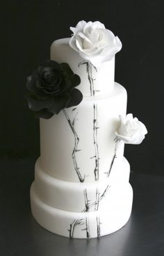 Black, & White Roses with painted stems Cake
