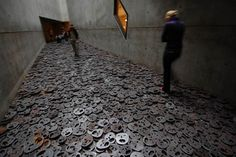 "Yad Vashem – Holocaust Museum Jerusalem. Another pinner says, ""The Memory Void, an installation by Israeli artist Menashe Kadishman, is especially chilling: a long, narrow room covered with ""Fallen Leaves""—piles of screaming faces. You walk across these faces respectfully, and no matter how gingerly you move, the sounds created are loud and abrasive. You hear these screeching sounds from the adjacent gallery—the echoes are eerie."""