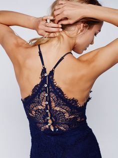 She's Got It Slip | High neck lace slip with a mother of pearl buttondown back. A fitted style, with soft, jersey lining.