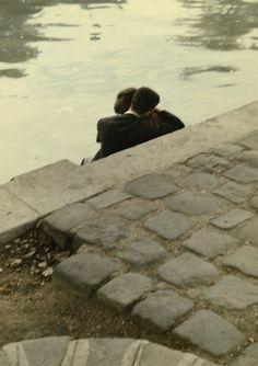 Lovers on the banks of the River Seine near the Square du Vert-Galant, Ile de la Cité, Peter Cornelius.
