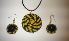 Pendand and earrings in Fimo clay varbished with resin. A twist of yellow..