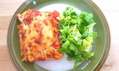 This chicken enchilada recipe yields a large casserole dish filled to the brim with soft tortillas that are stuffed full of delicately spiced tender chicken strips and slices of sweet bell peppers and is topped with a tangy tomato sauce and encrusted with golden grilled cheese. It's simply the perfect Mexican meal.