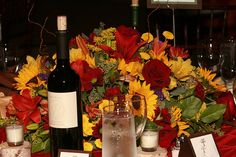 Centerpiece: Sunflower and Rose Mix by Rose of Sharon-Event Florist, via Flickr