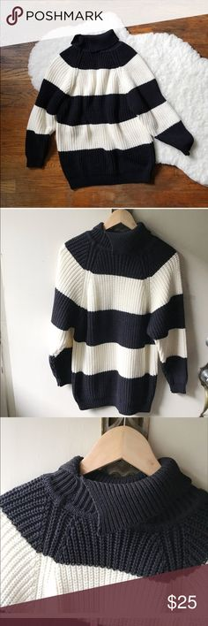 medium knit chunky striped sweater This cute sweater in my opinion best fits a medium, it is missing fabric content and size tags.  It is in great condition.  Please look at pic #3. There I am showing the style of turtle neck this sweater has, it opens on one side.  No trades. Please look at all pictures for more details and measurements. Color block sweater. Black and white. unknown Sweaters Cowl & Turtlenecks