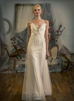 Sleeveless, Satin Column/Sheath Wedding Gown Showcasing An Appliqued Bodice With Plunging V Neckline & Tulle A-Line Overlay; by Elizabeth Fillmore Spring 2016××××