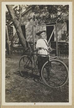 vintage boy with bicycle