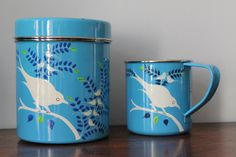 Pretty hand-painted enamel mug and tea tin by Nkuku, hand painted by skilled artisans living in Kashmir.