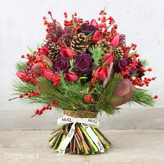 Bouquet for winter wedding. Including pinecones, but it's still a festive combination of colours!