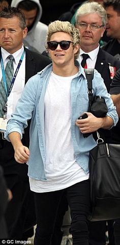 Niall Horan is all smiles as 1D arrived in Sydney. via MailOnline