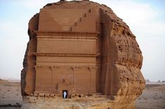 A Saudi man leaves a tomb carved into rose-coloured sandstone mountains in the Nabataean archaeological site of al-Hijr near the northwestern town of al-Ula, Saudi Arabia, on September 30, 2012. Dating back to the first century BC, the archaeological site has long been hidden from foreign visitors in this ultra-conservative kingdom that rarely opens up to tourists. According to UNESCO, it includes 111 tombs, most of which boast a decorated facade, cave drawi