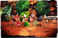 Tiny garden fairies with magic potions, in small glass bottles (3 cm aprox) Handmade from cold porcelain clay.