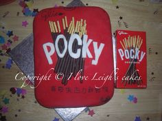"Pocky!! Japanese chocolate snack.  Chocolate sponge. Made by ""I love Leigh's cakes"""