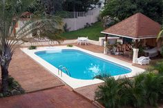 A picture of a Rectangle inground pool with 4' radius corners, stairs, ladder, and concrete deck.