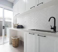 Modern Hamptons style laundry with while shaker cabinetry and matt black taps. F… Modern Hamptons style laundry with while shaker cabinetry and matt black taps. Fresh white and stylish. Laundry Room Tile, Modern Laundry Rooms, Laundry Room Storage, Laundry Room Design, Kitchen Design, Kitchen Tiles, Kitchen Flooring, Perth, Budget Bathroom