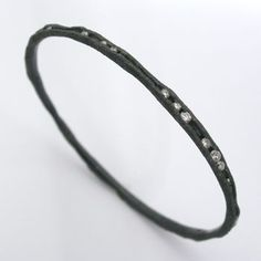 Todd Pownell Bracelet in oxidized sterling silver with 40 channel set diamonds