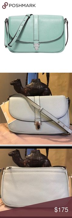 "• Michael Kors Celadon Charlton small Crossbody • Beautiful NWT Michael Kors Charlton Celadon blue Crossbody purse. 100% authentic, comes with care card and tags still attached. No flaws! Retails for $198. Dimensions: 9"" L x 6"" H x 2"" W Michael Kors Bags Crossbody Bags"