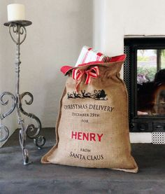 MONET + SOX Personalised hessian Christmas sack from Santa Claus in black print.  This is our original screen-printed hessian Christmas sack designed by monet+sox Australia, as seen in House and Garden magazine December 2014.  A delightful Christmas gift for children and mums and dads alike, it will look like it has just come off Santa's sleigh on Christmas day and been placed under your tree.  The personalised message reads:  'CHRISTMAS DELIVERY DECEMBER 25TH FOR [NAME] FROM SANTA CLAUS'…