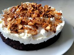 Kahlua Chocolate Poke Cake--topped with vanilla whipped cream and sugared almonds