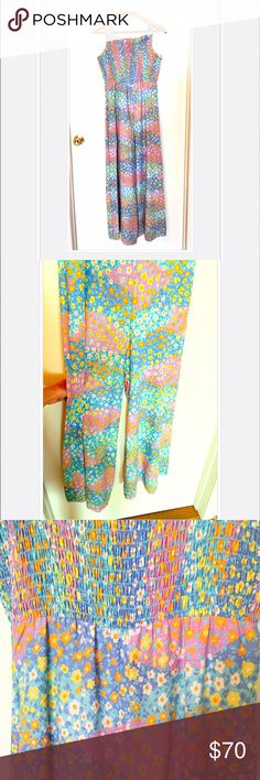 Vintage floral wide leg palazzo pants romper Amazing vintage 60's/ 70's wide leg palazzo pants jumpsuit. Colorful floral print. Size small-medium. Stretch material above waist. Excellent condition. Pants Jumpsuits & Rompers