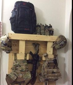 closet gear setup... just needs an outlet to charge the radio and flashlight. and a clothing bar to hang uniforms Tactical Survival, Survival Gear, Survival Prepping, Tactical Gear, Survival Skills, Military Equipment, Tactical Equipment, Military Gear, Bushcraft