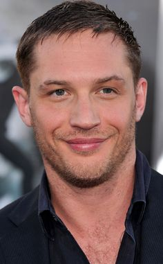 We have a huge crush on Tom Hardy! Those lips! So hot. (Click to see more of our fave Hot British Celebs.)