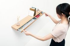 Clopen is a minimalist design created by Japan-based designers Torafu Architects. What looks like a floating shelf, the design actually hides a secret compartment locked in place by magnets. The 23mm deep shelf is opened by using the butt end of the magnet in the key. (3)
