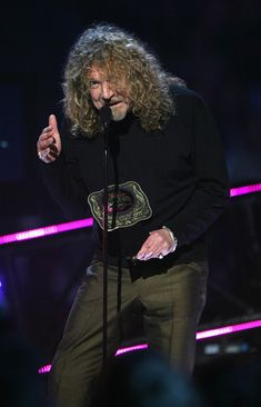 Robert Plant Photos Photos - Musician Robert Plant onstage during the 2008 CMT Music Awards at the Curb Events Center at Belmont University on April 14, 2008 in Nashville, Tennessee. - 2008 CMT Music Awards - Show