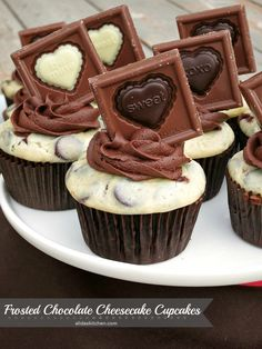 Frosted Chocolate Cheesecake Cupcakes: chocolate cake filled with chocolate chip cheesecake topped with chocolate frosting and a chocolate candy square. Decadent, delicious and easy! | alidaskitchen.com