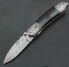 Anyone like this Knife? I am thinking about producing it and want the input of YOU please let me know what you think.