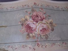 Hand painted roses on a lid of a Shabby Chic trunk