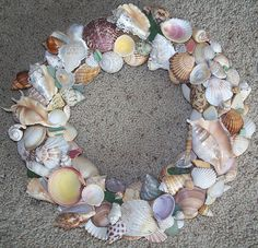 I had fun making this wreath.  It is one of my favorites.  Includes sea glass and pottery found at glass beach and some of the seashells I found in the south of France and on beaches in Spain.