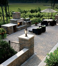 Patio: outdoor kitchen; fireplace; seating; stonework (prefer bluestone patio but this brick looks nice)