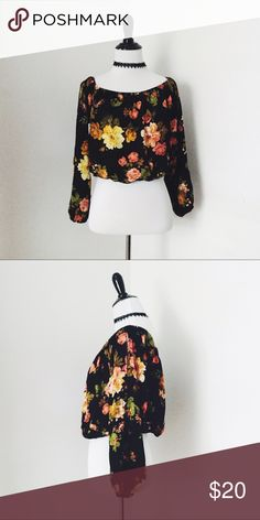 Floral off the shoulder top Off the shoulder black floral top. This item is cropped and has elastic waist on bottom. Could be won on shoulders or off. Has cutout detailing on sleeves. Great spring and summer item. Never worn. Tops