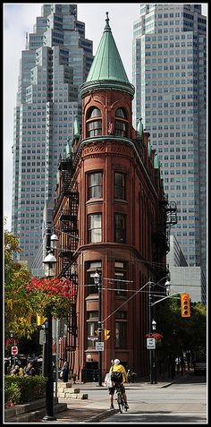 Flat-iron building in Toronto, Canada - by Alex Me