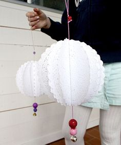 DIY Doily Pom Poms. Party decorations?