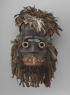 Mask (Gbona Gla)  late 19th to early 20th century Wood, feathers, fiber, pigment, hide, human hair, cowtail hair, boar tusk, animal teeth, cloth, nails, and encrustation Object: 63.5 x 38.1 x 22.86 cm (25 x 15 x 9 in.) Charles B. Benenson, B.A. 1933, Collection 2006.51.524 Geography:  Made in Guinea Coast, Ivory Coast Made in Guinea Coast, Liberia Culture:  Wè