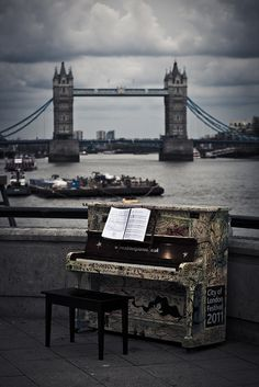 who doesn't already love the london bridge, much less with a piano randomly along the tthames