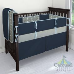 Crib bedding in Solid Navy, Ash Gray Anchors, Solid Aqua, Solid Cloud Gray. Created using the Nursery Designer® by Carousel Designs where you mix and match from hundreds of fabrics to create your own unique baby bedding. #carouseldesigns