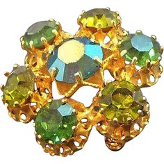 Vintage Aurora Green Rhinestone Pin Made in Austria.  found at www.rubylane.com #vintagebeginshere