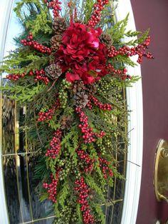 "Christmas Teardrop Swag Door Decor..""Seasons Greetings"". $80.00, via Etsy."