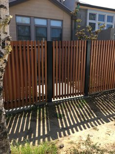 Black or charcoal posts and railings with timber pickets Front Yard Fence, Farm Fence, Fence Gate, Fence Panels, Driveway Gate, Timber Gates, Timber Fencing, Privacy Fence Landscaping, Backyard Fences