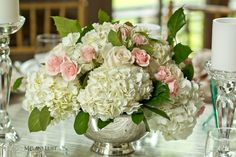 Beautiful hydrangea and rose centerpiece at Lord Thompson Manor in CT created by The Flowering Vine.