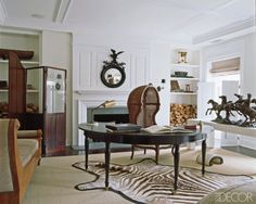A porter chair and Carter-designed desk in the master bedroom; a bronze sculpture sits atop a vintage Parsons table, and the convex mirror is 19th century.   - ELLEDecor.com